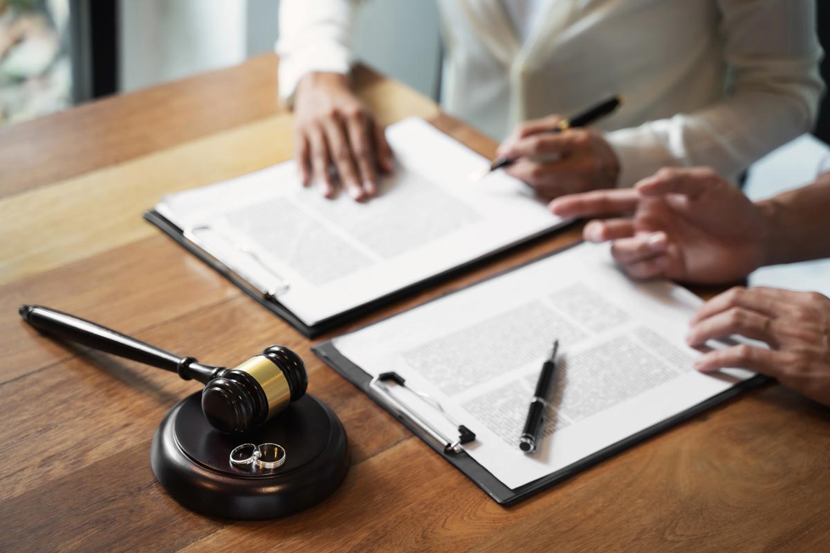 Alberta Divorce lawyer with client discussing separation agreement